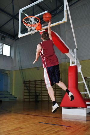one healthy young  man play basketball game in school gym indoor Stock Photo - 5272427