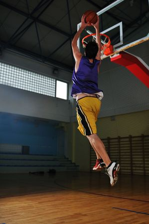 one healthy young  man play basketball game in school gym indoor Stock Photo - 5272721