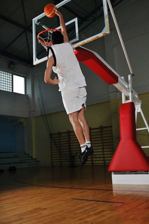 one healthy young  man play basketball game in school gym indoor Stock Photo - 5272602