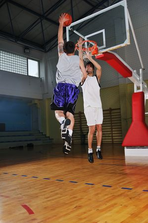 competition cencept with people who playing basketball in school gym Stock Photo - 5272735