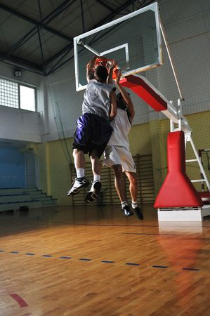 competition cencept with people who playing basketball in school gym Stock Photo - 5272511
