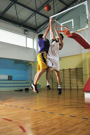 basketball duel with two young basketball player at sport indoor gym photo