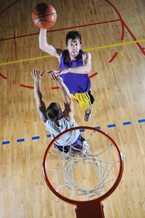 sport hall: competition cencept with people who playing basketball in school gym