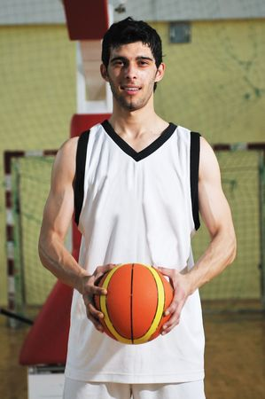 one basket ball game player standing in sport gym with ball Stock Photo