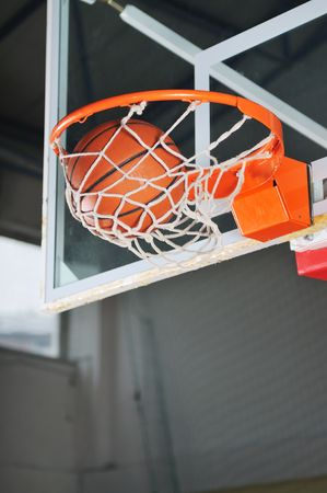oreange basket ball in basketball basket Stock Photo - 5298283