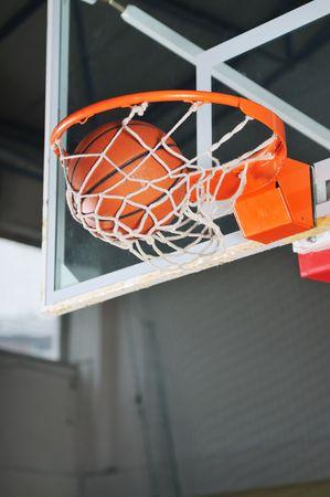 oreange basket ball in basketball basket Stock Photo - 5298283