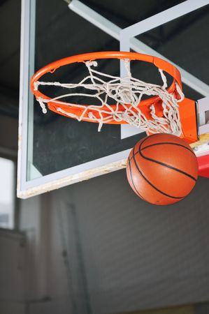 hand baskets: oreange basket ball in basketball basket Stock Photo