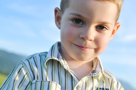 happy young boy child outdoor portrait photo