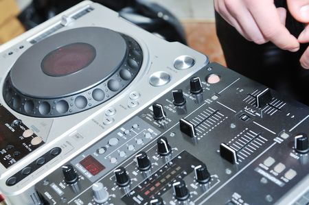 dj equipment gramophone and mixete with dj hand on party event photo