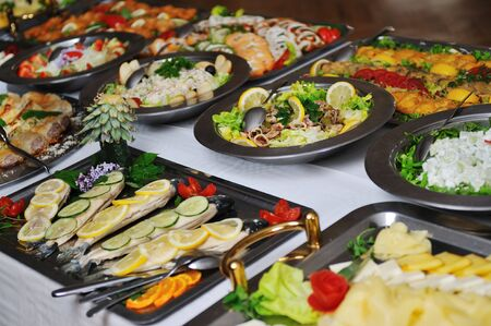 banquets: buffet catering food arangement on table Stock Photo