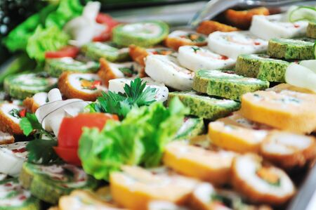 prepared food: buffet catering food arangement on table Stock Photo