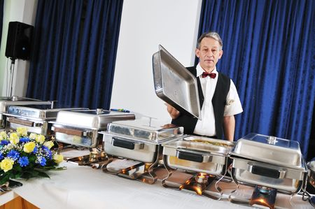cater: catering buffet food party preparation man Stock Photo