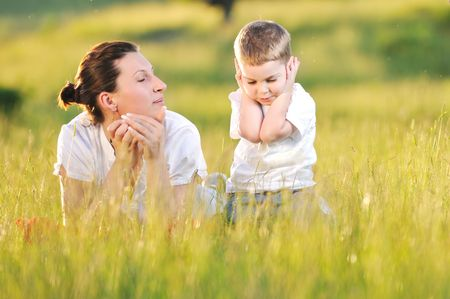 happy young woman mother play and outdoor with beautiful child  Stock Photo - 5330922