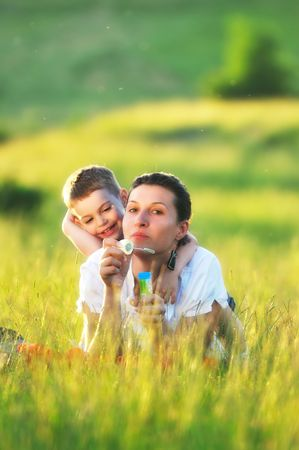 happy young woman mother play and outdoor with beautiful child  Stock Photo - 5336055