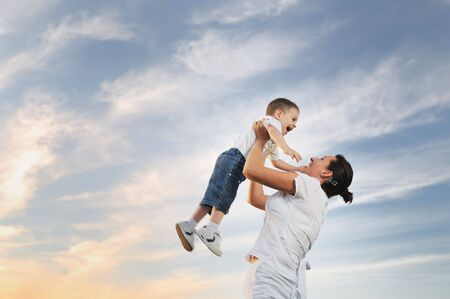 play boy: happy young woman mother play and outdoor with beautiful child