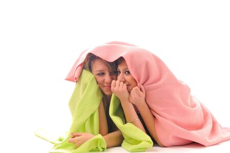 two youg happy giril woman smiling unger blanket isolated representing concept of lesbian love, happynes and softnes photo