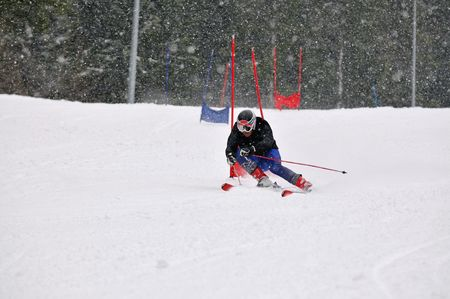 young skier race fast downhil at winter snow scene  photo