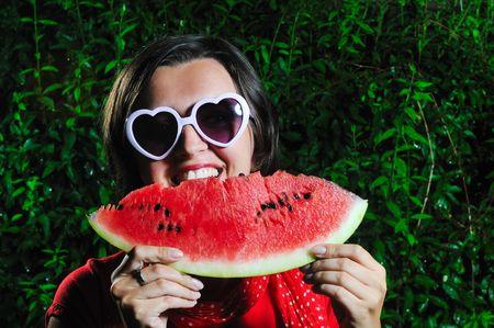funny fashion happy woman with heart shape heart and watermelon Stock Photo - 5331104
