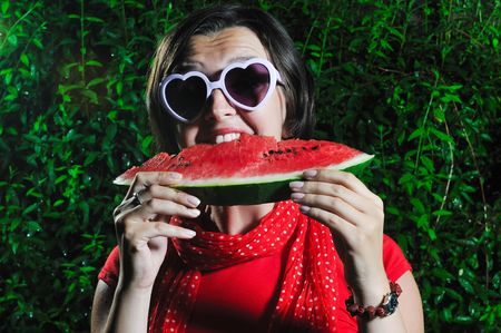 funny fashion happy woman with heart shape heart and watermelon  photo