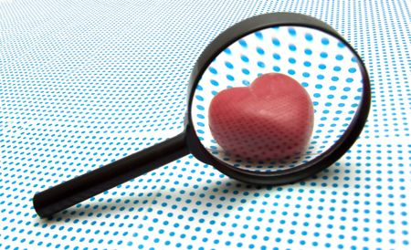 reading material: magnifying glass Stock Photo
