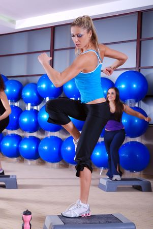 step fitness: woman stepping in a fitness center Stock Photo