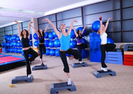 group of girls stepping in a fitness club photo