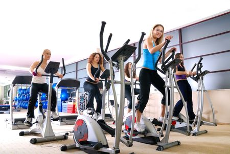 fitness model: group of girls working out on treadmill at  fitness gym