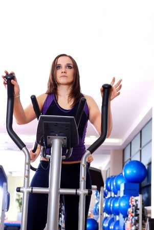 pretty woman working out at spinning bike at fitness gym Stock Photo - 5293858