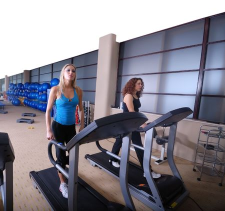 group of girls working out on treadmill at fitness gym Stock Photo - 5295658