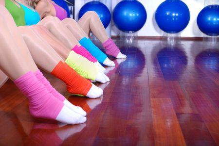 fitness exercise with girls and colorful socks in focus photo