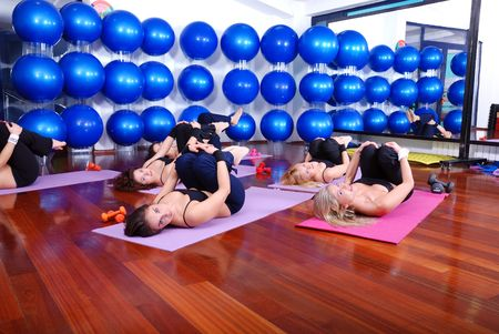 leisure centre: health club: women doing stretching, fitness, aerobics and yoga exercise