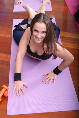 young pretty woman exercising in a fitness center photo