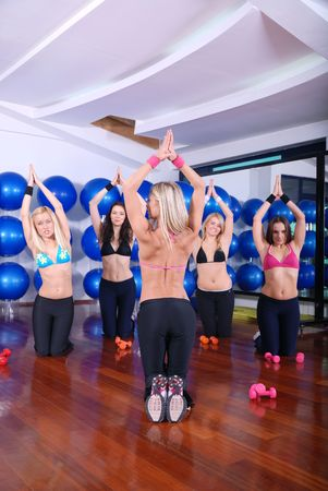health club: women doing stretching, fitness, aerobics and yoga exercise photo