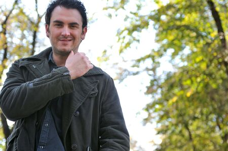 eyecontact: happy young casual man outdoor portrait posing Stock Photo