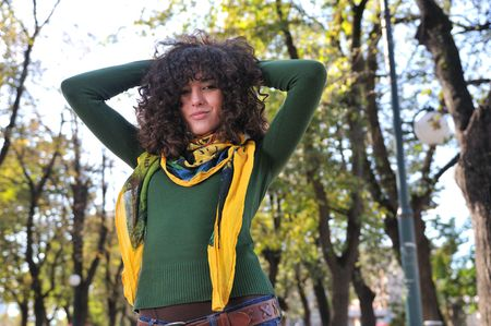 eyecontact: brunette Cute young woman with colorful scarf posing outdoors in nature