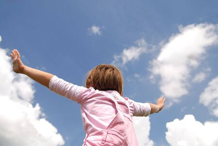 woman arms up: girl with arms wide open and sky background (Multiple values) Stock Photo