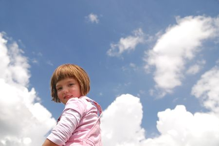 arms wide open: girl with arms wide open and sky background (Multiple values) Stock Photo