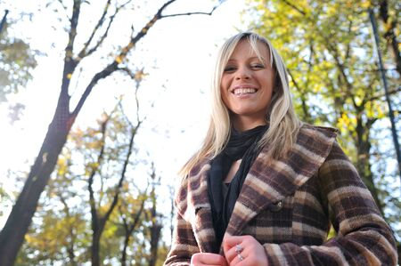 eyecontact: Cute young woman smiling outdoors in nature