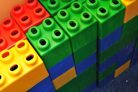 playcentre: colorful brick toy background in child playground