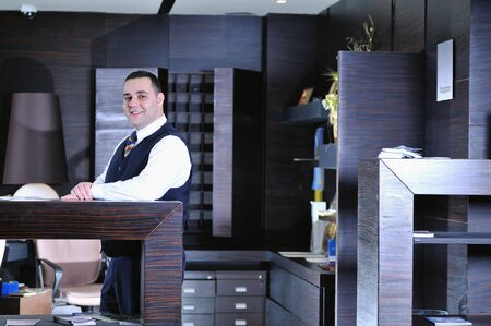 accommodations: reception service man hotel indoor smile travel