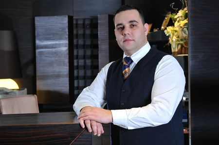 reception service man hotel indoor smile travel  photo