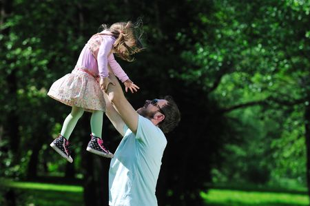 happy man and girl family play outdoor photo