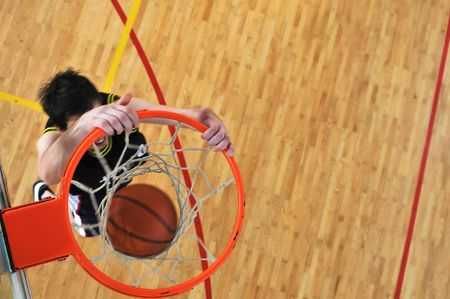 one healthy young  man play basketball game in school gym indoor photo