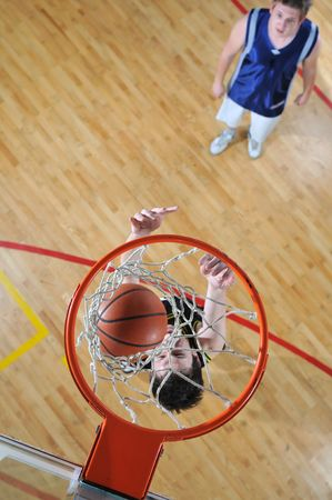 competition cencept with people who playing basketball in school gym  Stock Photo - 5339890