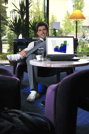 buisinessman: Young buisinessman sitting and working on buisiness solution Stock Photo