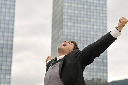 Photo of happy winner businessman  screaming from joy   photo