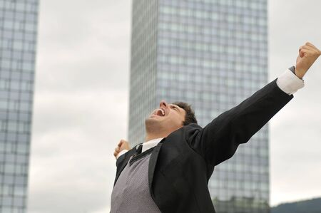arms wide: Photo of happy winner businessman  screaming from joy