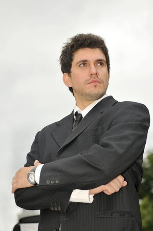 Outdoor portrait of young and happy  businessman photo