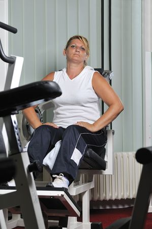 Mature healthy woman work out in fitness photo