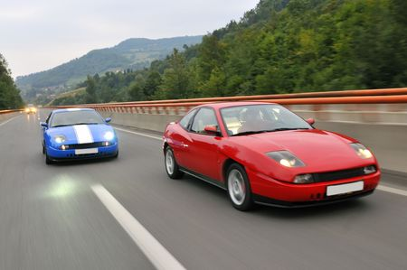 super highway: Two hot tuning cars racing Stock Photo